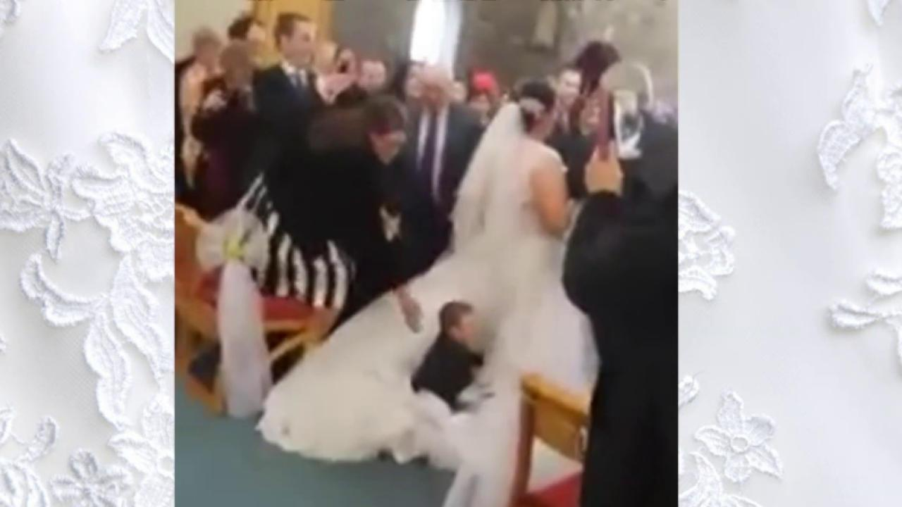 Here Comes the Dive! 4-Year-Old Launches Himself Onto Bride's Train