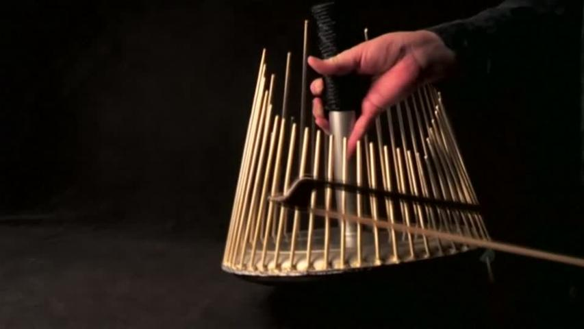Musician demonstrates the unique sound of the waterphone instrument