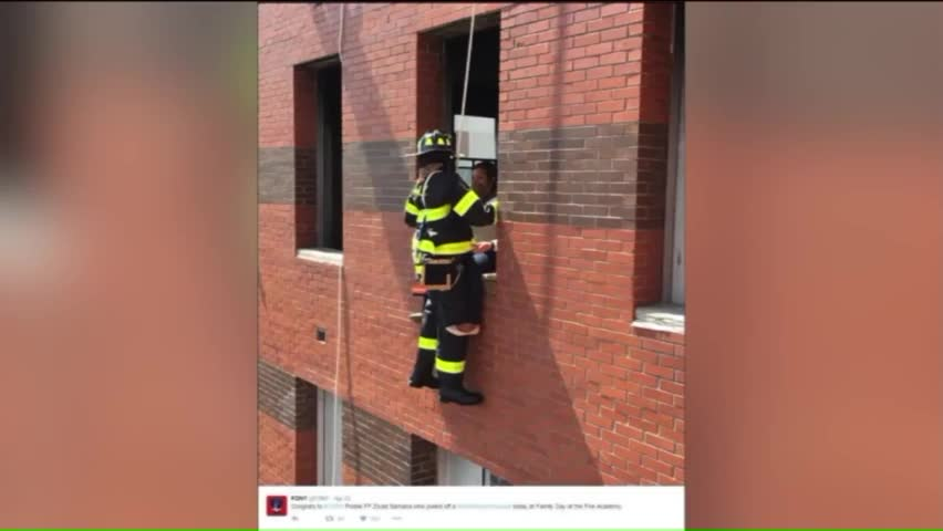 Firefighter Proposes to Girlfriend While Hanging from Side of Building