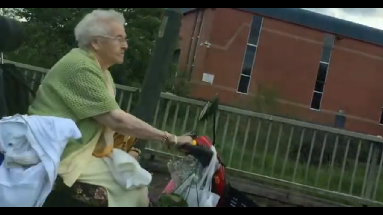 Woman Drives Mobility Scooter Through Rush Hour Traffic