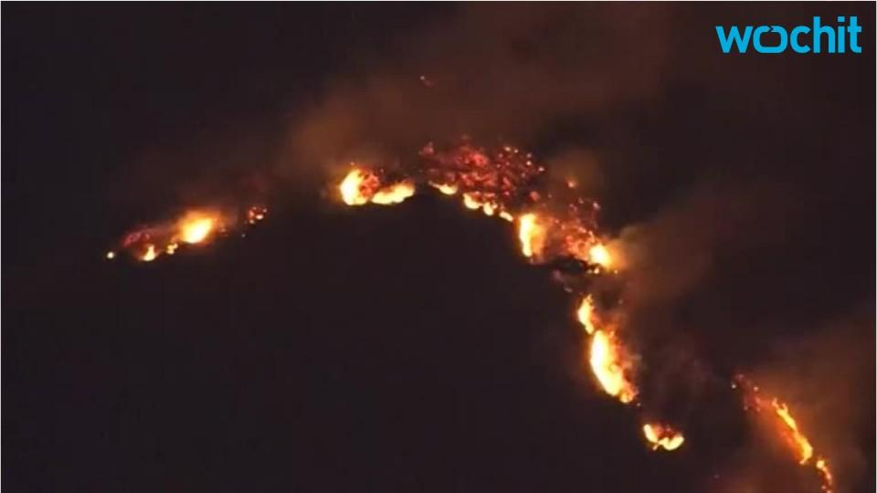 Los Angeles Area wildfires push against firefighting crews
