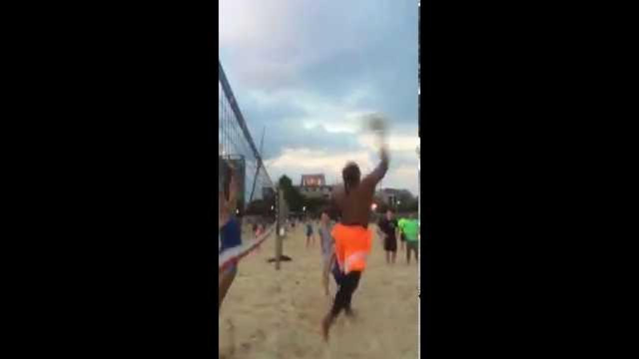 Cam Newton Blocked by a Girl When Playing Beach Volleyball