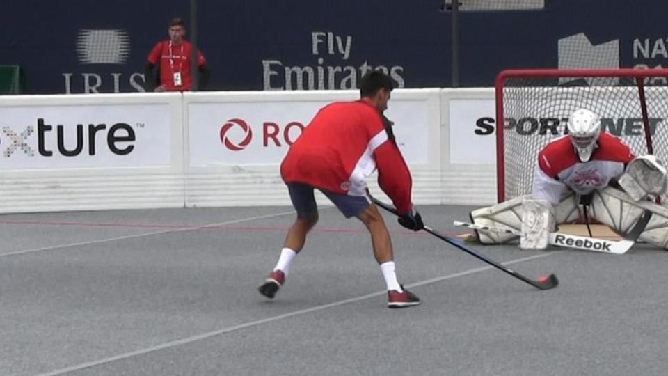 Novak Djokovic trades in his tennis racket for a hockey stick