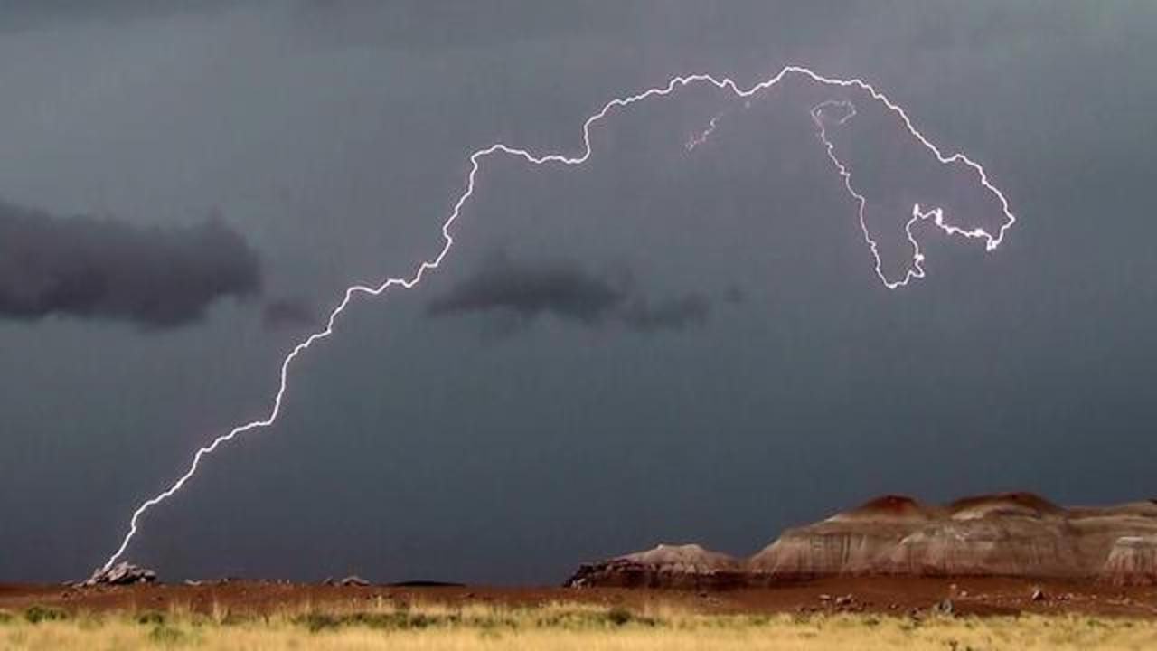 Viral Shot Of Lightning Bolt Looks Like T. Rex About To Chomp On Blue Mesa Formation