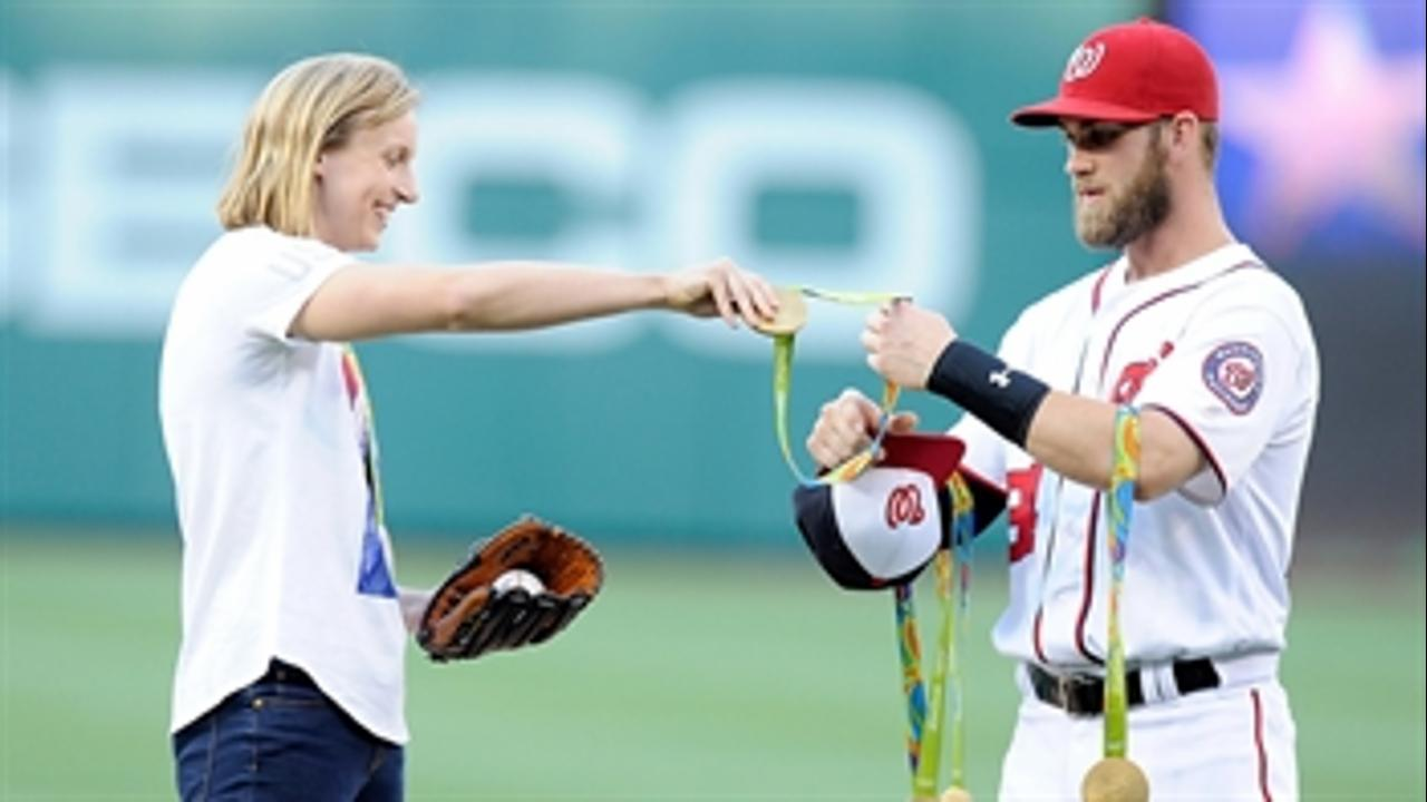 Katie Ledecky tosses first pitch with help from Bryce Harper
