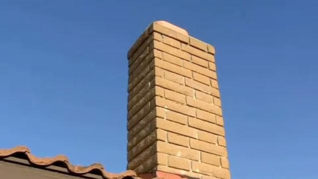 Naked Woman Rescued From Chimney