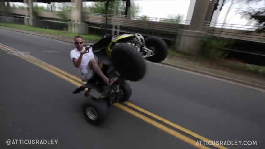 Guy popping wheelie on ATV results in head-on collision