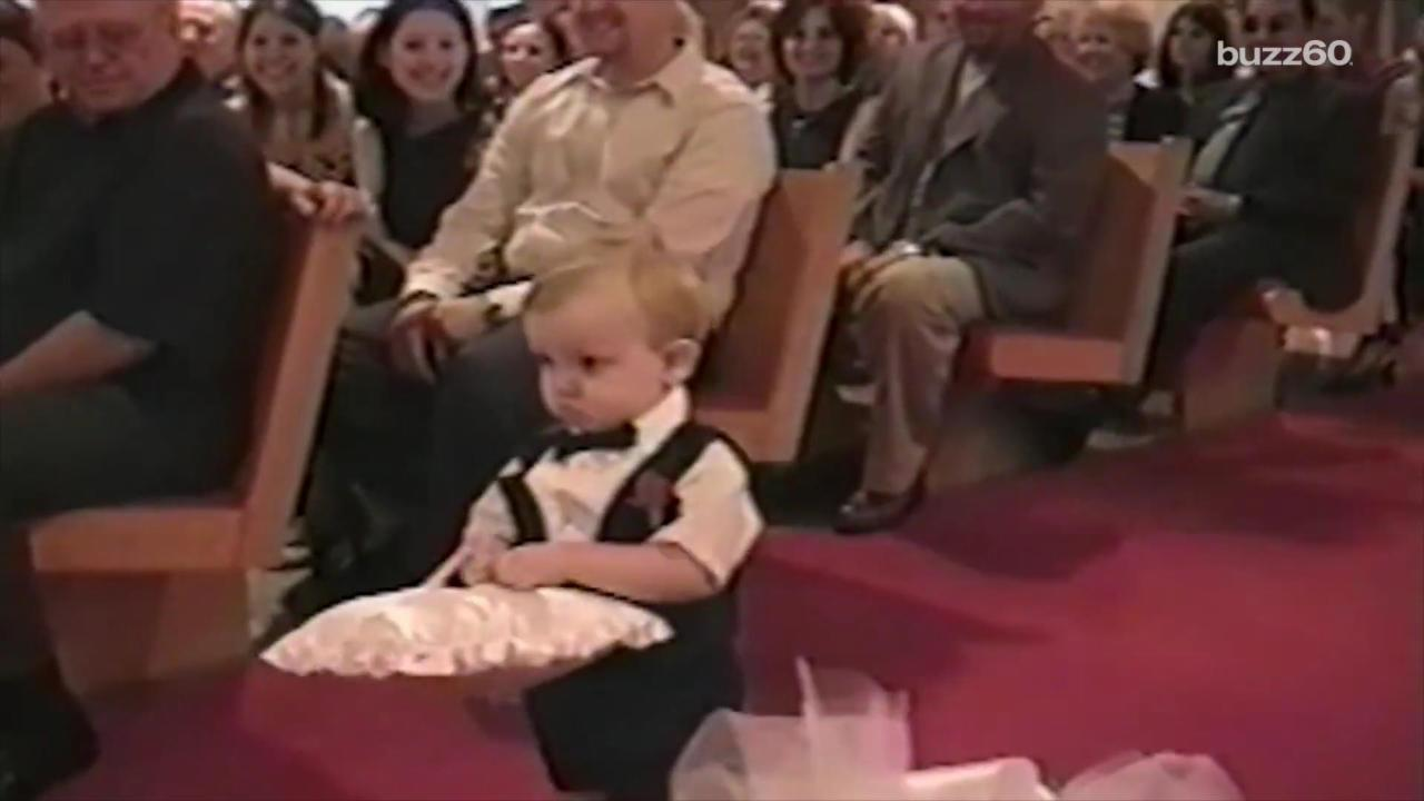 Adorable ring bearer doesn't know what to do, throws pillow