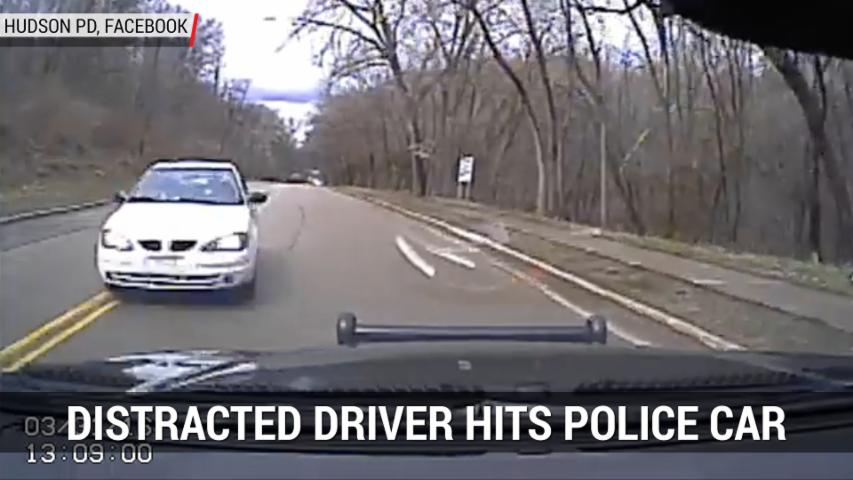 Distracted Driver Hits Police Car | Autoblog Minute