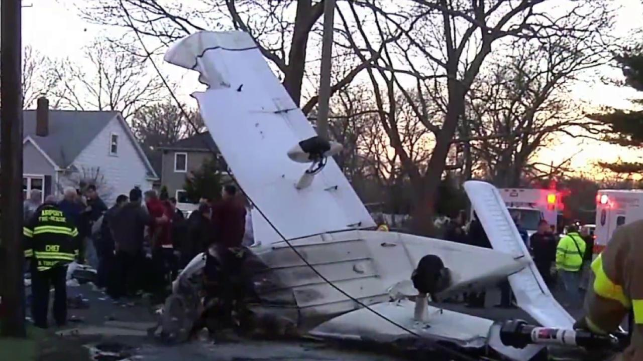 Small plane lands on Long Island suburban street; 2 injured