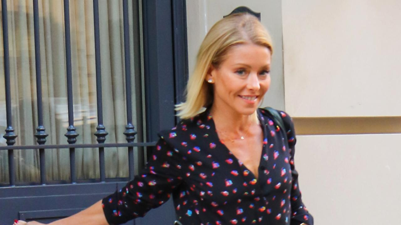 Kelly Ripa Surfaces With a Book and a Smile