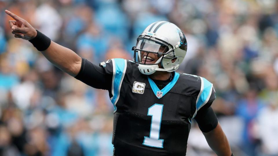 Watch: Cam Newton hops fence to play football with seventh-graders