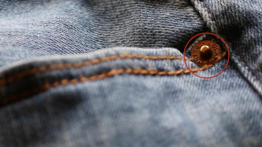 Why Do Jeans Have Little 'Buttons' Around Pockets