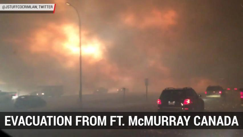 Dramatic Video Shows Wildfire Evacuation From Fort McMurray Canada | Autoblog Minute