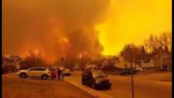 Huge Wildfire Turns Fort McMurray Skies Brown and Yellow