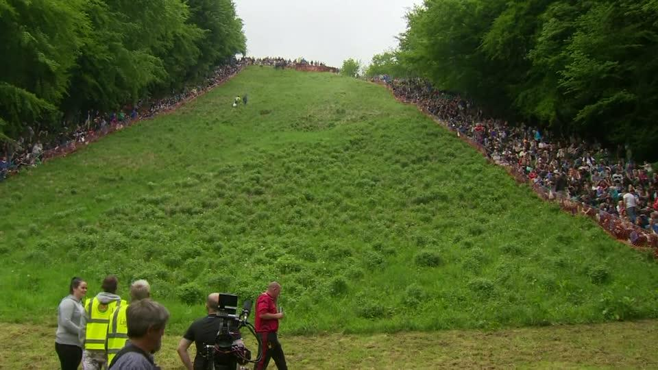 Competitors take a tumble in annual cheese rolling race