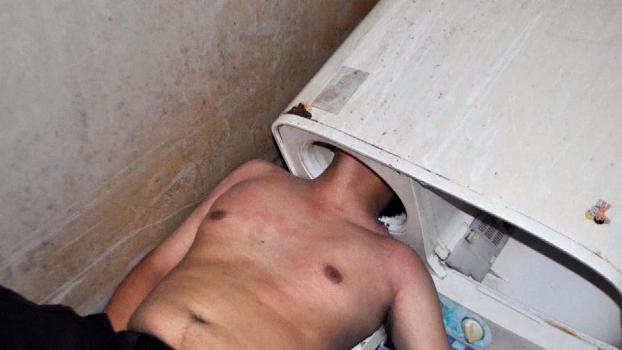 Man Gets Head Stuck in Washing Machine
