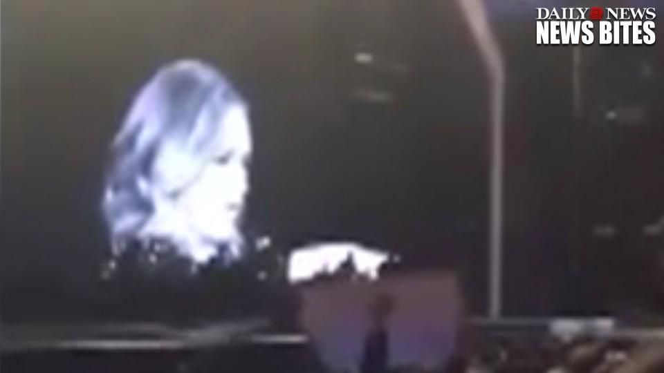 Adele yells at fan to stop filming her concert