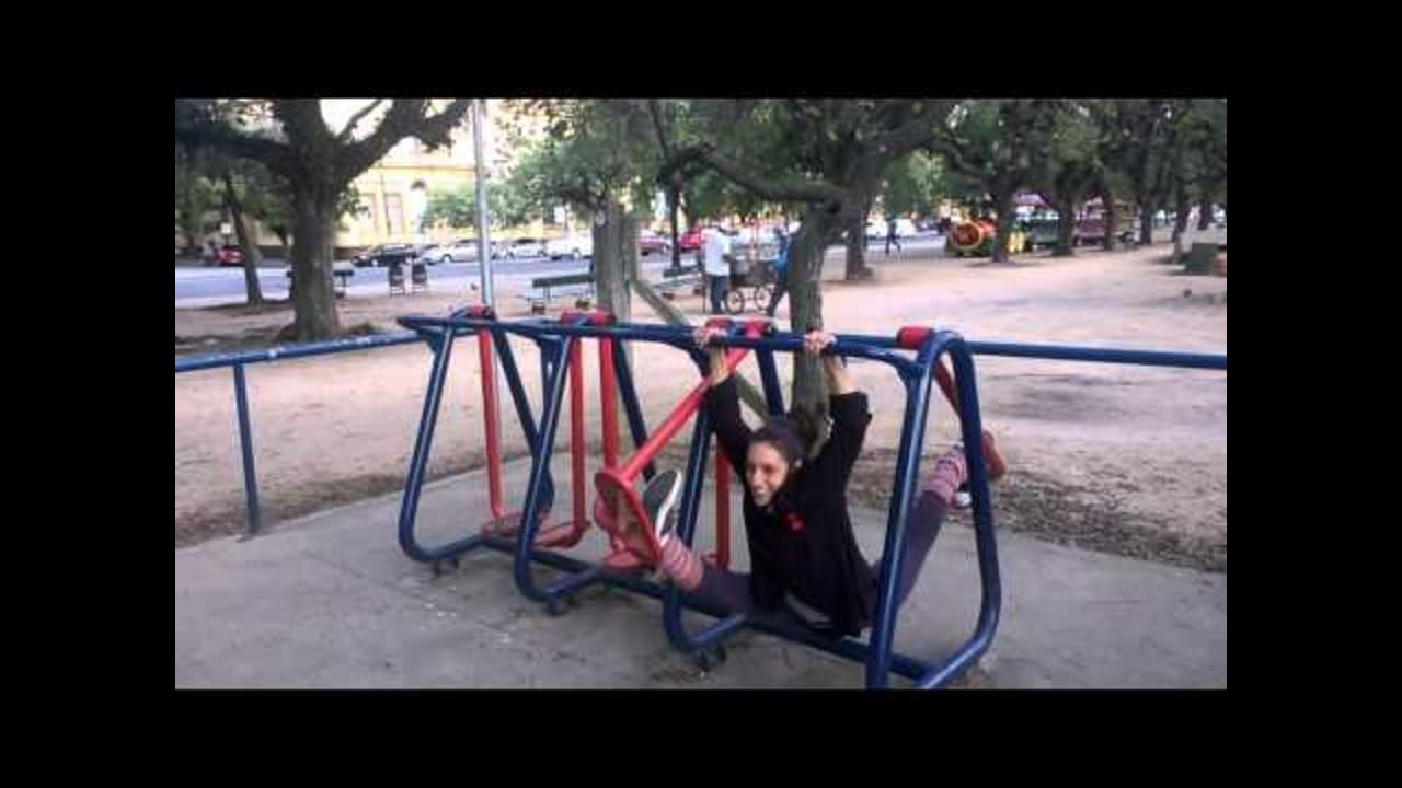 Circus Performer Shows Off Flexibility on Street Gym Machine