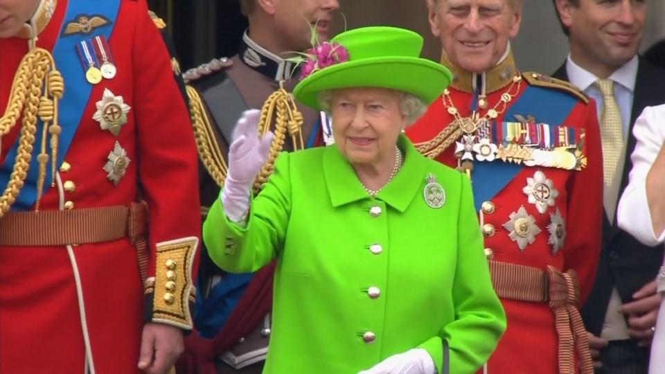 Queen marks 90th birthday with colorful parade