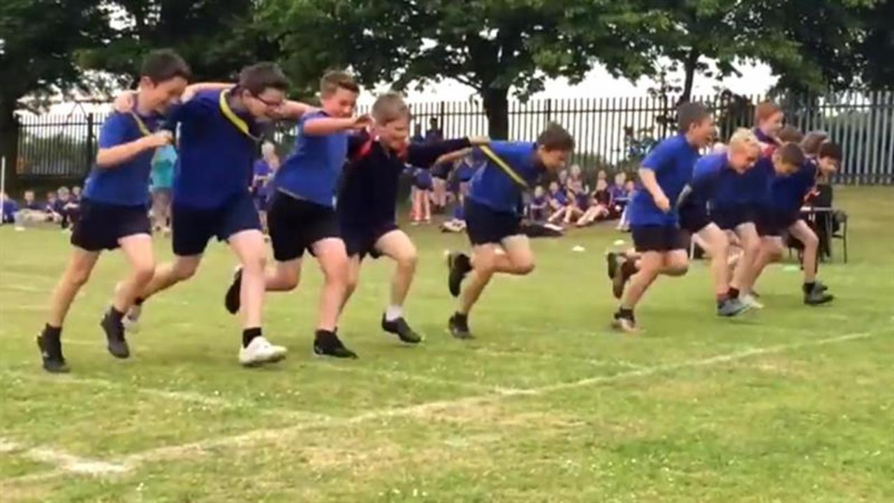 A group of boys work together to let 11-year-old with Down syndrome win race