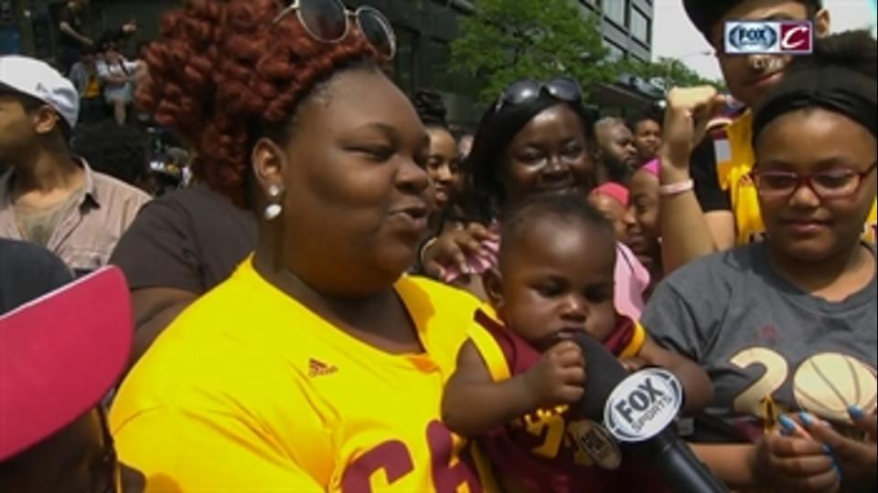 This adorable baby stole the show - and a part of a reporter's microphone - at the Cavs' championship parade