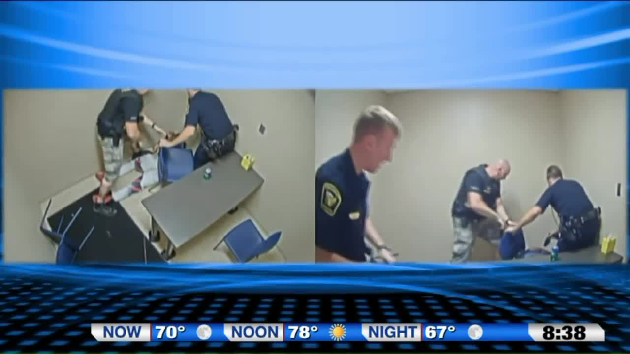 Murder Suspect Attempts To Take Officer's Gun During Intense Moment In Interview Room