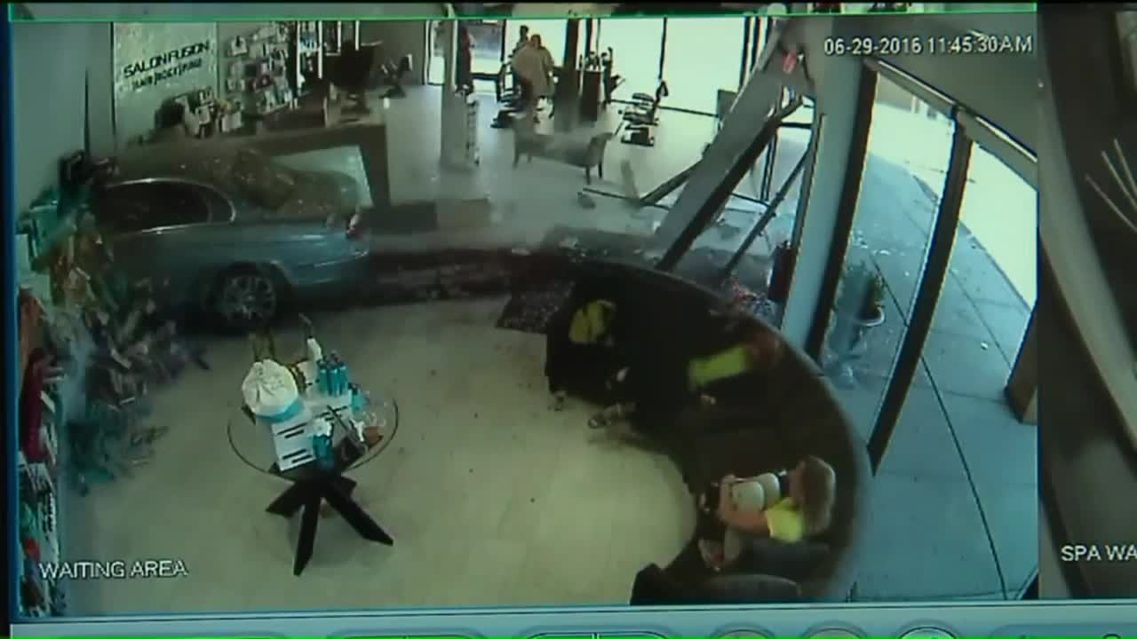 Terrifying Surveillance Video Captures Moment Car Crashes Through Salon