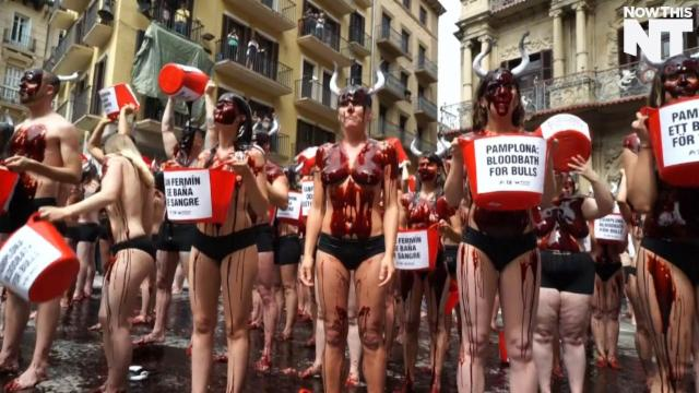 Protesters Pour Fake Blood on Themselves to Protest Running of the Bulls