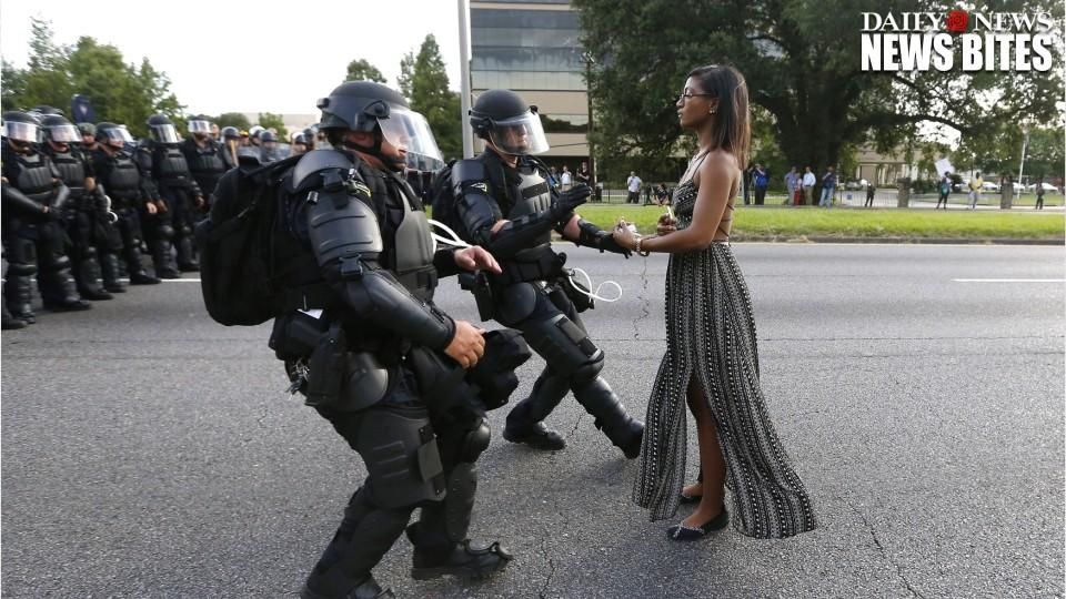 Photo of woman facing with Lousiana police goes viral