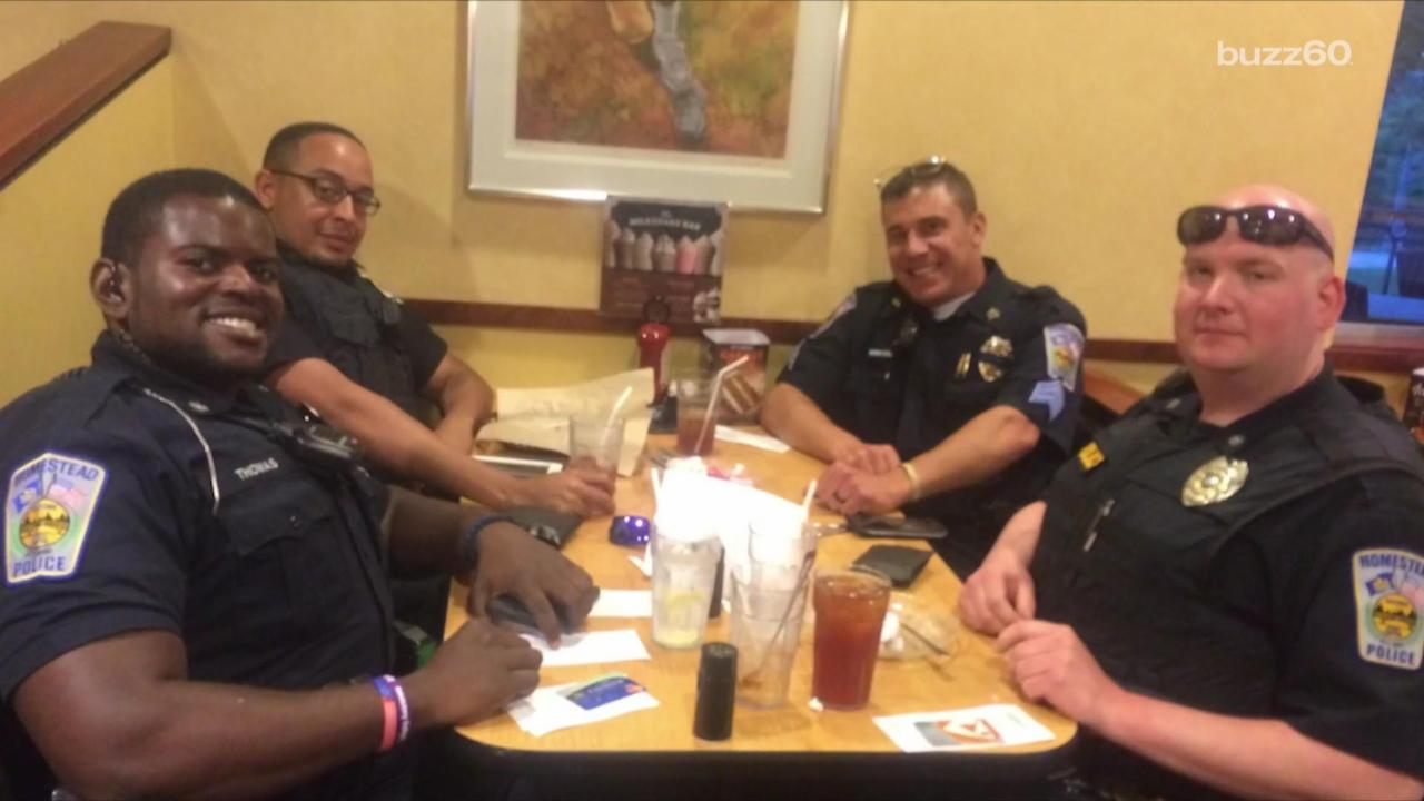 Police Officers Pay Tab For Couple Who Refuses to Sit Next to Them