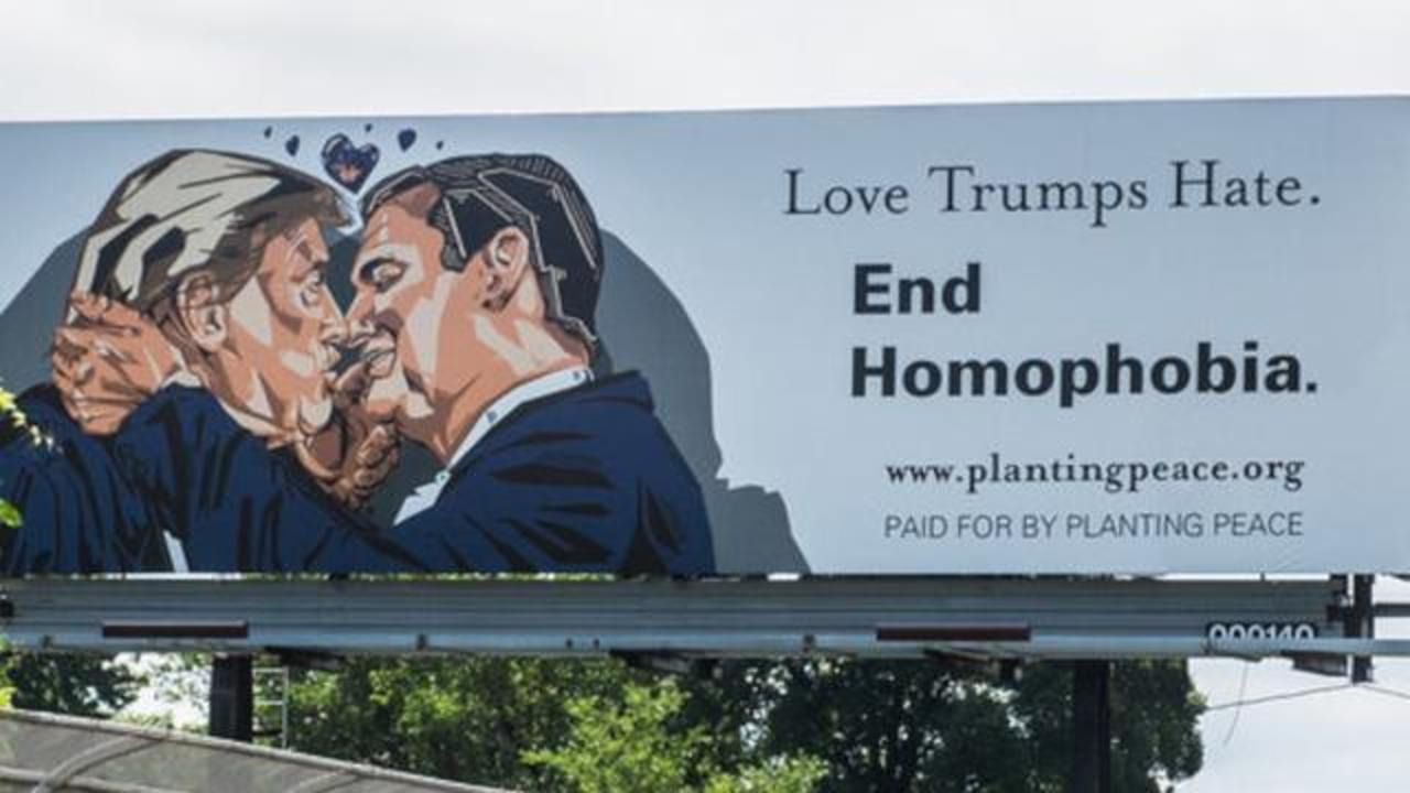 Billboard Of Donald Trump And Ted Cruz Kissing Placed Near