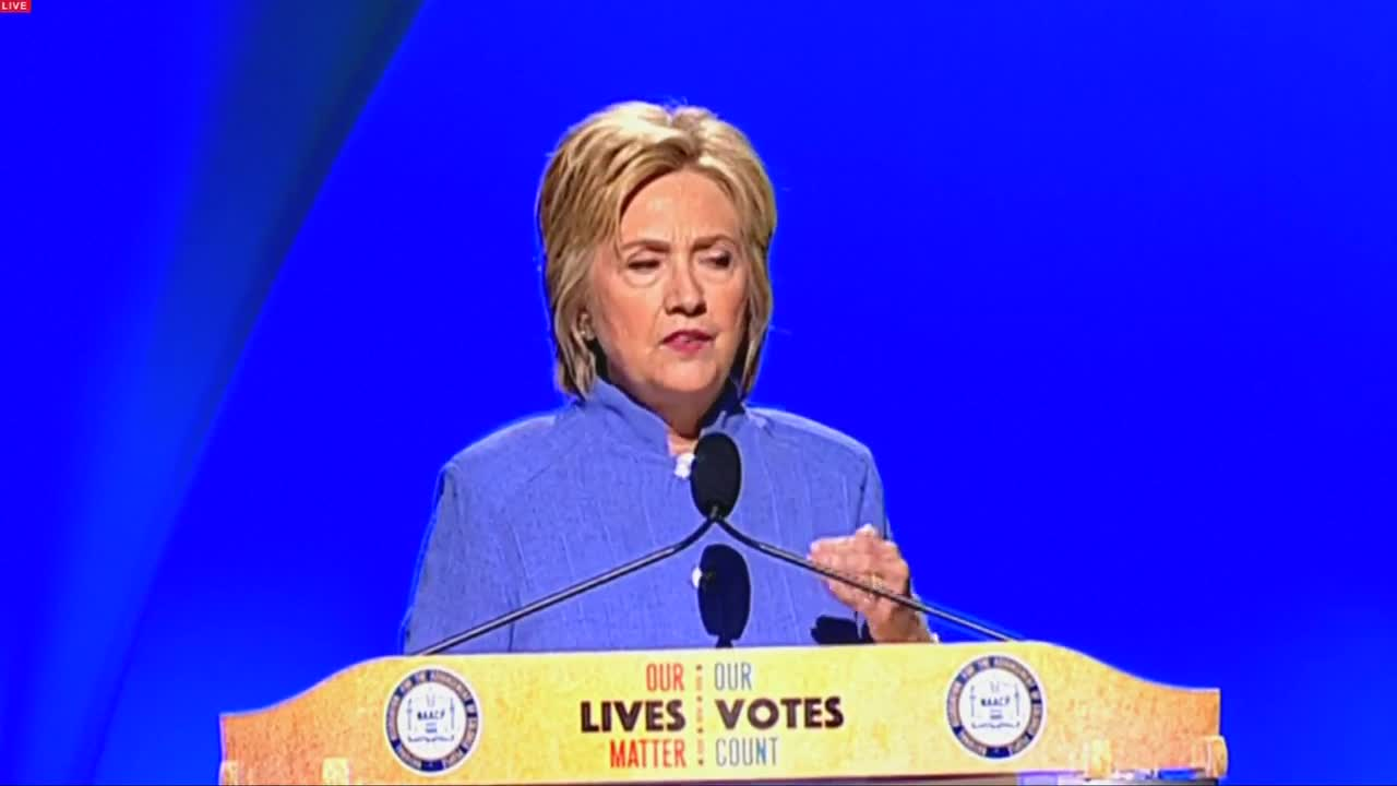 Clinton promises to prosecute police killers