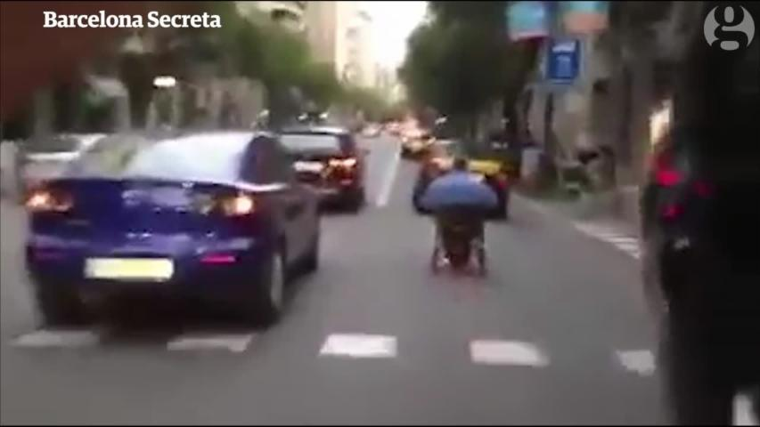 Wheelchair user speeds down busy street in Barcelona