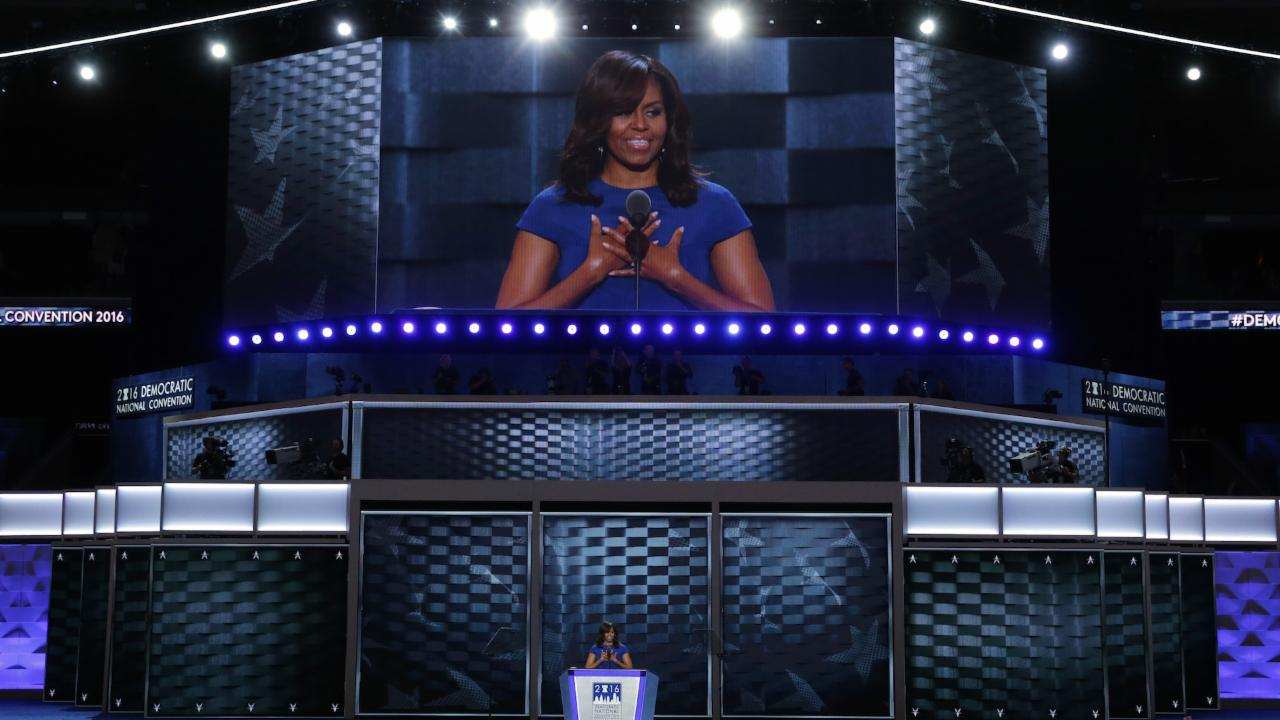 Michelle Obama: Clinton 'never buckles under pressure'