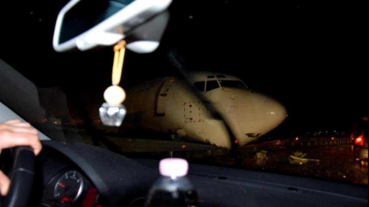 Motorists Drive Past Plane That Skidded Off Runway