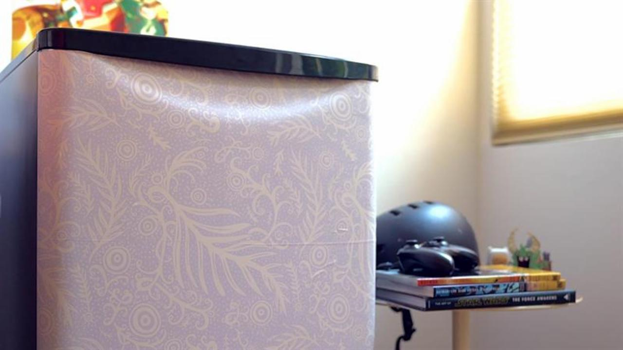 Decorate your dorm room mini fridge with stick-on wallpaper