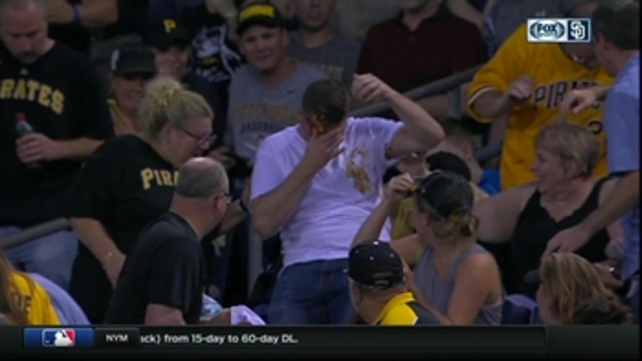 Pirates fan misses foul ball, dumps ketchup and mustard on to his own face