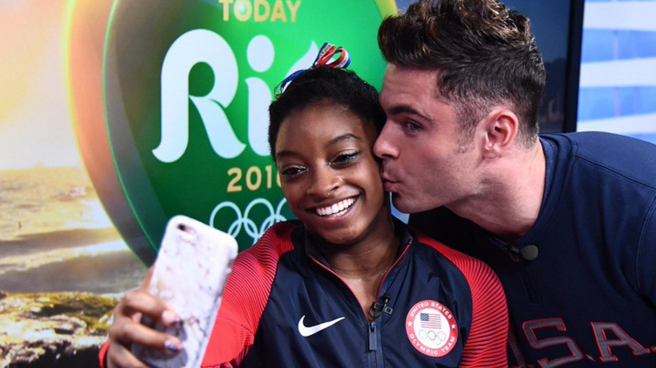 Simone Biles finally met Zac Efron and he gave her a kiss