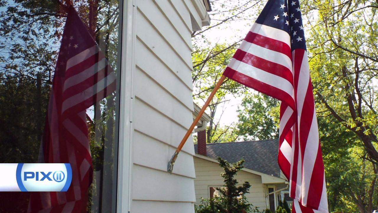 Woman Facing Fine for Displaying American Flag on Door